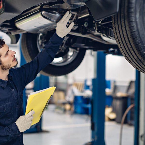 Auto car repair service center. Mechanic examining car Cheltenham